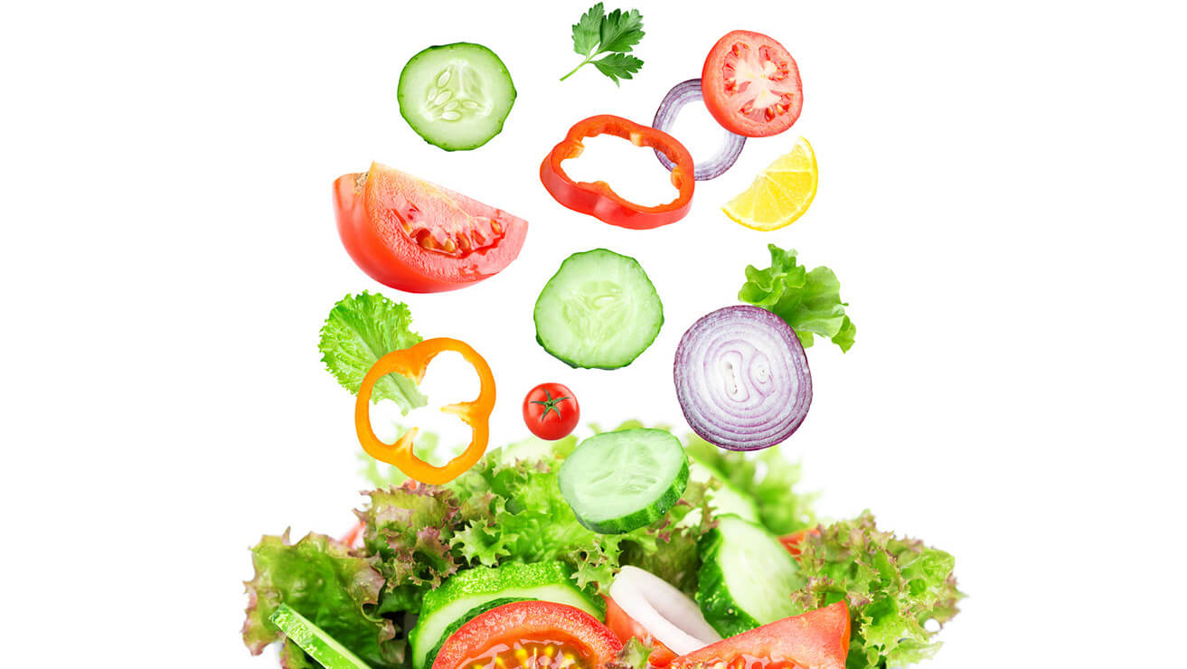 Eating green leafy vegetables for healthy gums